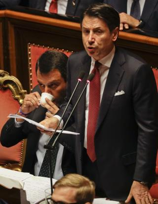Italian PM Quits, Blames Guy Sitting Next to Him