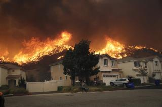 Fires Rage Across California as Lights Go Out