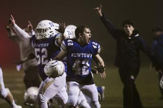 Newtown Posts Victory on Painful Anniversary