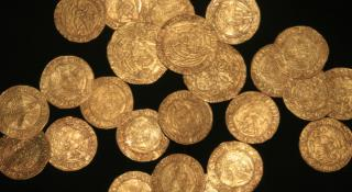 Family Weeding Garden Finds Hoard of Gold Coins