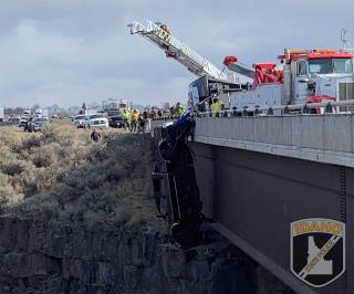 Truck Dangles Over Gorge— With 2 Inside