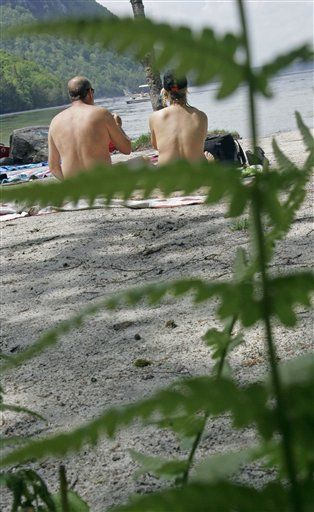 In French Town, Nudists Battle Nudists