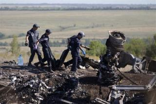 More Bodies Found in MH17's Chaotic Recovery