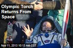 Olympic Torch Returns From Space