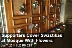 Supporters Cover Swastikas at Mosque With Flowers