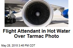 Flight Attendant in Hot Water Over Tarmac Photo
