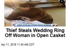 Thief Steals Wedding Ring Off Woman in Open Casket