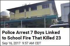 Police Arrest 7 Boys Linked to School Fire That Killed 23