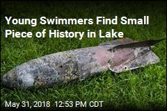 Girls Playing in Lake Discover WWI Practice Bomb