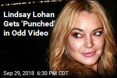Lindsay Lohan Gets 'Punched' in Odd Video