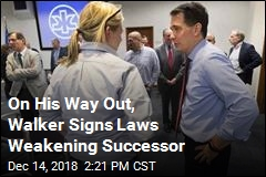 On His Way Out, Walker Signs Laws Weakening Successor