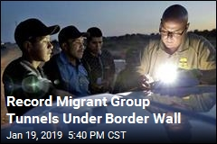 Record Migrant Group Tunnels Under Border Wall