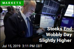 Stocks End Wobbly Day Slightly Higher