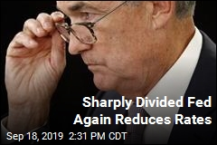 Sharply Divided Fed Again Reduces Rates