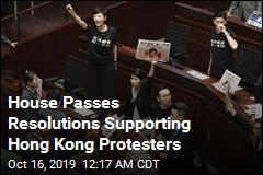 Protests Halt Hong Kong Leader's Policy Speech