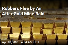 Robbers Flee by Air After Gold Mine Raid