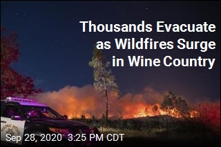Winds Push Wildfires Through Wine Country. Thousands Flee
