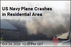 US Navy Plane Crashes in Residential Area