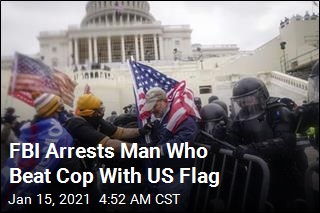 Man Arrested for Beating Capitol Cop With US Flag