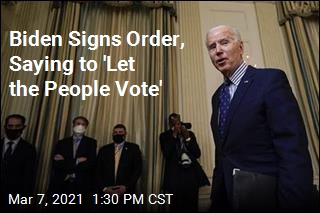 Biden Signs Order, Saying to 'Let the People Vote'